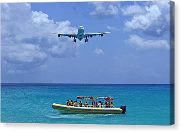 Passenger Airplane Overflies Boat. Canvas Print by Fernando Barozza