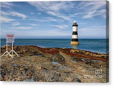 Penmon Point Lighthouse Canvas Print by Adrian Evans