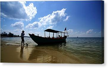Canvas Print featuring the photograph People And Boat by Arik S Mintorogo