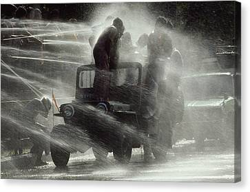 People Are Sprayed At The Water Canvas Print by James L. Stanfield