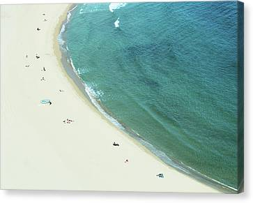 People Relaxing On Beach Canvas Print by G Fletcher