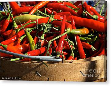 Peppers And More Peppers Canvas Print by Susan Herber