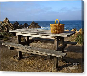 Picnic Basket On Wooden Picnic Table Canvas Print