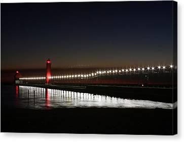 Pier Lights At Sunset Canvas Print by Richard Gregurich