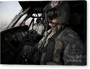 Pilot In The Cockpit Of A Uh-60l Canvas Print by Terry Moore