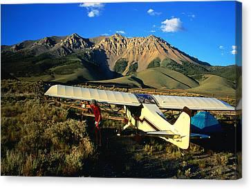 Pilot Of Ultralight Plane Taking Camping Excursion, Near Borah Peak, Idaho, United States Of America, North America Canvas Print by Holger Leue