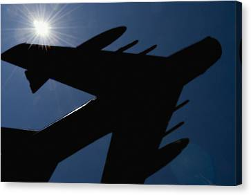 Airoplane Canvas Print - Plane Against The Sky  by Cliff Norton