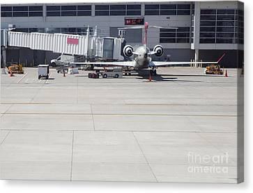 Plane At Gate Canvas Print by Shannon Fagan
