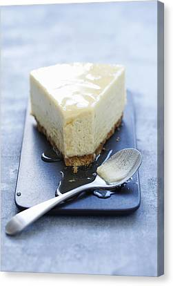 Plate Of Cheesecake With Syrup Canvas Print