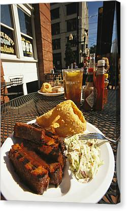 Plate Of Ribs And Rings At Famous Sonny Canvas Print by Richard Nowitz