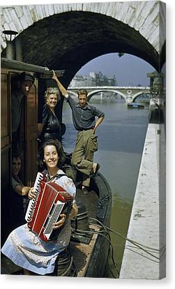 Playing And Listening To An Accordion Canvas Print by Justin Locke