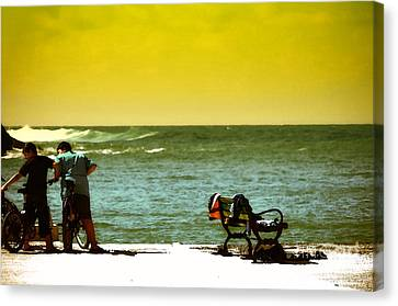 Playing At Beach Canvas Print by Nilay Tailor