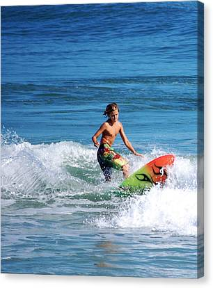 Playing In The Surf Canvas Print by David Lane