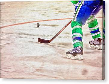 Playing The Puck Canvas Print by Karol Livote