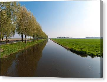 Canvas Print featuring the photograph Polder Ditch by Hans Engbers