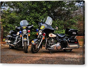 Police Motorcycles Canvas Print by Paul Ward