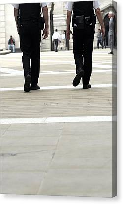 Police Officers Patrolling Canvas Print by Tony Mcconnell