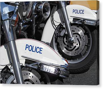 Police Wheels Canvas Print by Alfred Ng