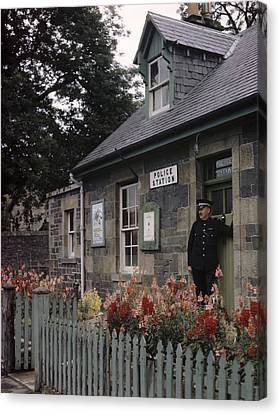 Policeman And Dog Stand At Police Canvas Print by B. Anthony Stewart