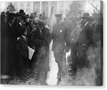 Policeman Leads An Arrested National Canvas Print by Everett