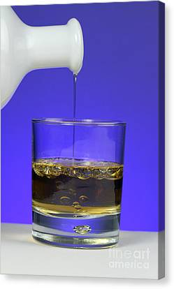 Pouring Oil Into Vinegar Canvas Print by Photo Researchers, Inc.