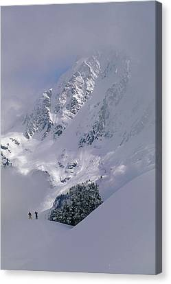 Powder Skiers Head Out-of-bounds Canvas Print by Gordon Wiltsie