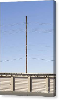 Power Line Pole Over Bay Doors Canvas Print by Dave & Les Jacobs