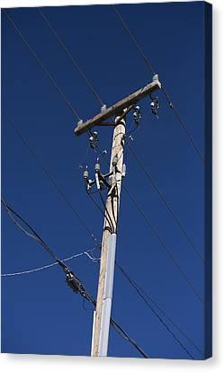 Power Lines Against A Clear Sky Canvas Print by John Burcham