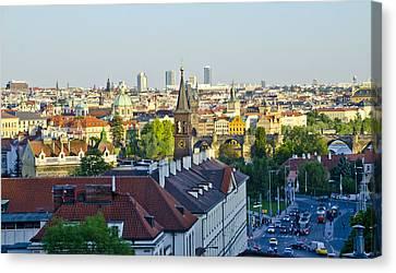Prague And St Charles Bridge Canvas Print by Jon Berghoff