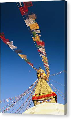 Prayer Flags Wave In The Breeze Canvas Print by Michael Melford