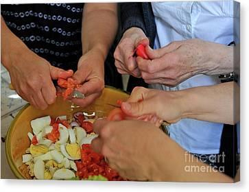 Preparing Salad Canvas Print by Sami Sarkis