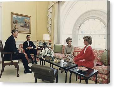 President And Nancy Reagan Having Tea Canvas Print by Everett