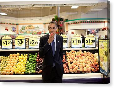 President Barack Obama Eats A Peach Canvas Print by Everett