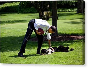 President Barack Obama Pets The Family Canvas Print by Everett