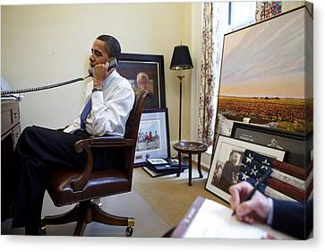 President Barack Obama Takes A Phone Canvas Print by Everett