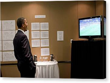 President Barack Obama Watches The U.s Canvas Print