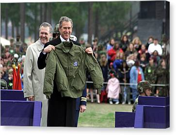 President Bush Displays A Jacket Given Canvas Print by Everett