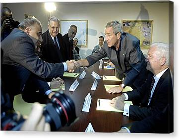 President George W. Bush Shakes Hands Canvas Print by Everett