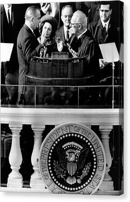 President Johnson Takes The Oath Canvas Print by Everett