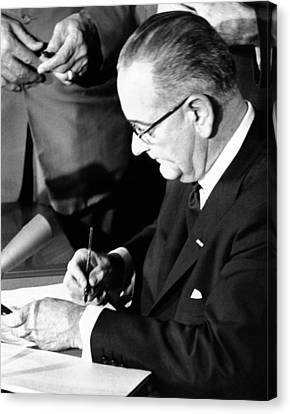 President Lyndon Johnson Signing Canvas Print by Everett