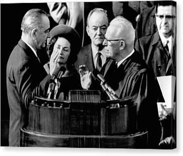 President Lyndon Johnson Takes The Oath Canvas Print by Everett