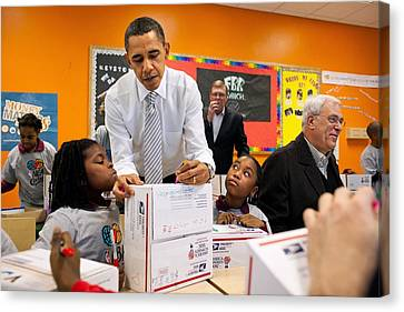 President Obama Flanked By Two Little Canvas Print by Everett