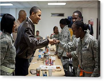 President Obama Greets A Female Soldier Canvas Print by Everett