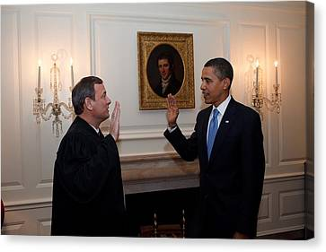 President Obama Is Given The Oath Canvas Print by Everett