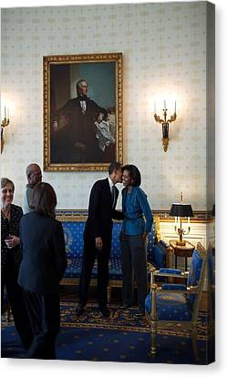 President Obama Kisses First Lady Canvas Print by Everett