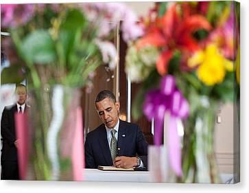 President Obama Signs A Condolence Book Canvas Print