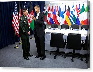 President Obama Talks With Gen. David Canvas Print