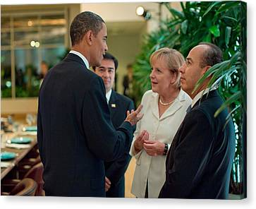 President Obama Talks With German Canvas Print by Everett