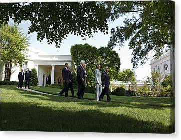 President Obama Walks With Members Canvas Print by Everett