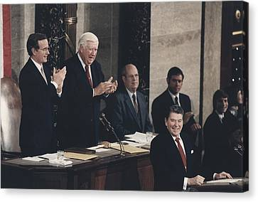 President Reagan Receives A Standing Canvas Print by Everett